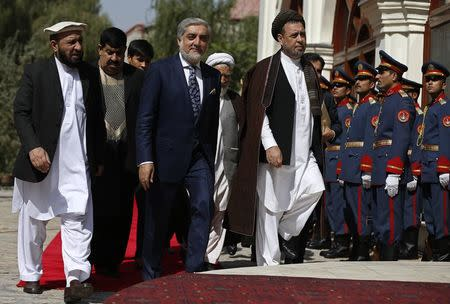 Abdullah Abdullah (C) arrives for inauguration as chief executive in Kabul September 29, 2014. REUTERS/Omar Sobhani