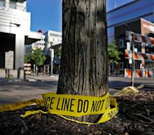 One woman dead, three injured after car plows into protesters in Minneapolis, police say