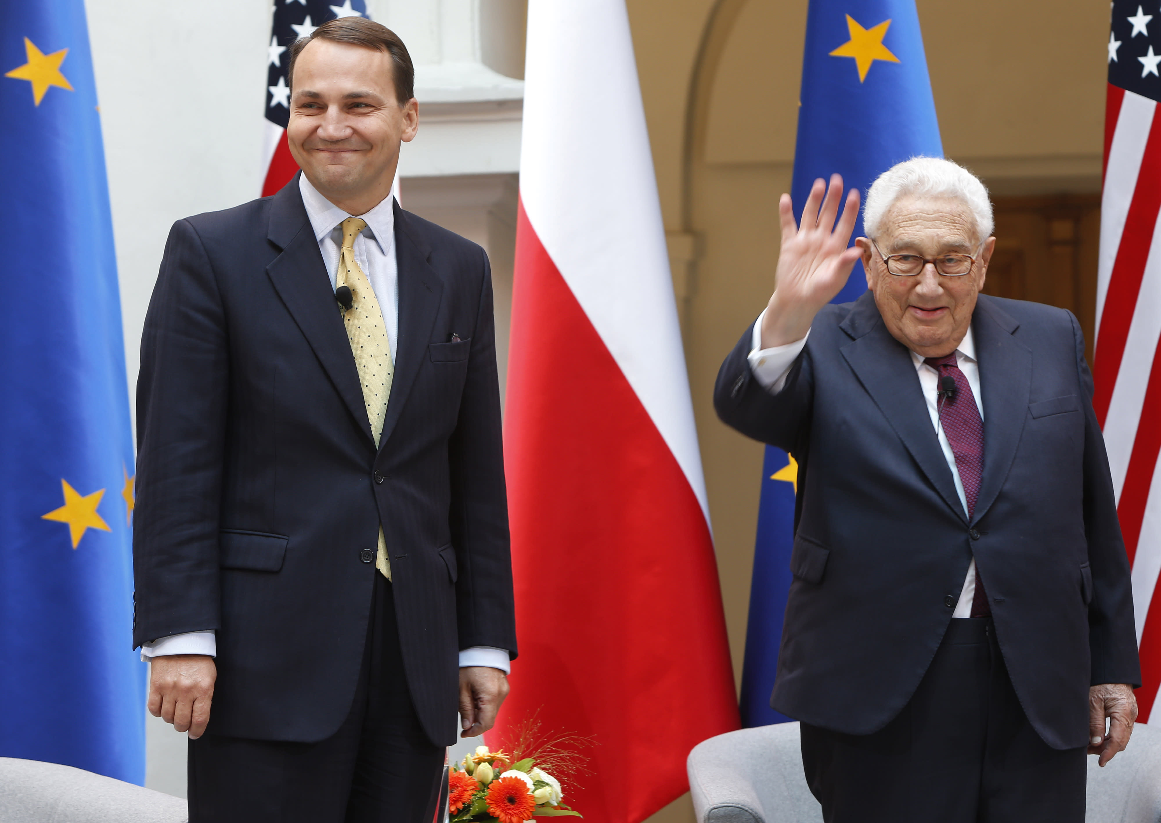 "Former U.S. Secretary of State Henry Kissinger, right, and Poland's Foreign Minister Radek Sikorski, left, ahead of discussions on Europe's strategic challenges in Warsaw, Poland, on Wednesday June 27, 2012. Kissinger was credited many years ago with asking whom he should call if he wants to call Europe. He told his Warsaw audience, to laughter: ""I am not sure I actually said it. But it's a good statement so why not take credit for it?"" He went on to say that that Europe today appears more unified due to the European Union but still lacks a common strategy. ""Even if a telephone exists and even if they answered it, the answer is not always very clear,"" Kissinger said. (AP Photo/Czarek Sokolowski)"