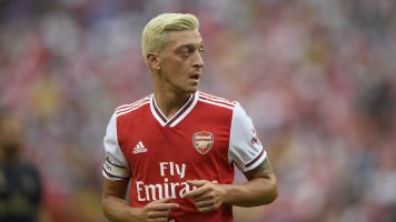 Ozil hits back at critics and vows not to 'run away'
