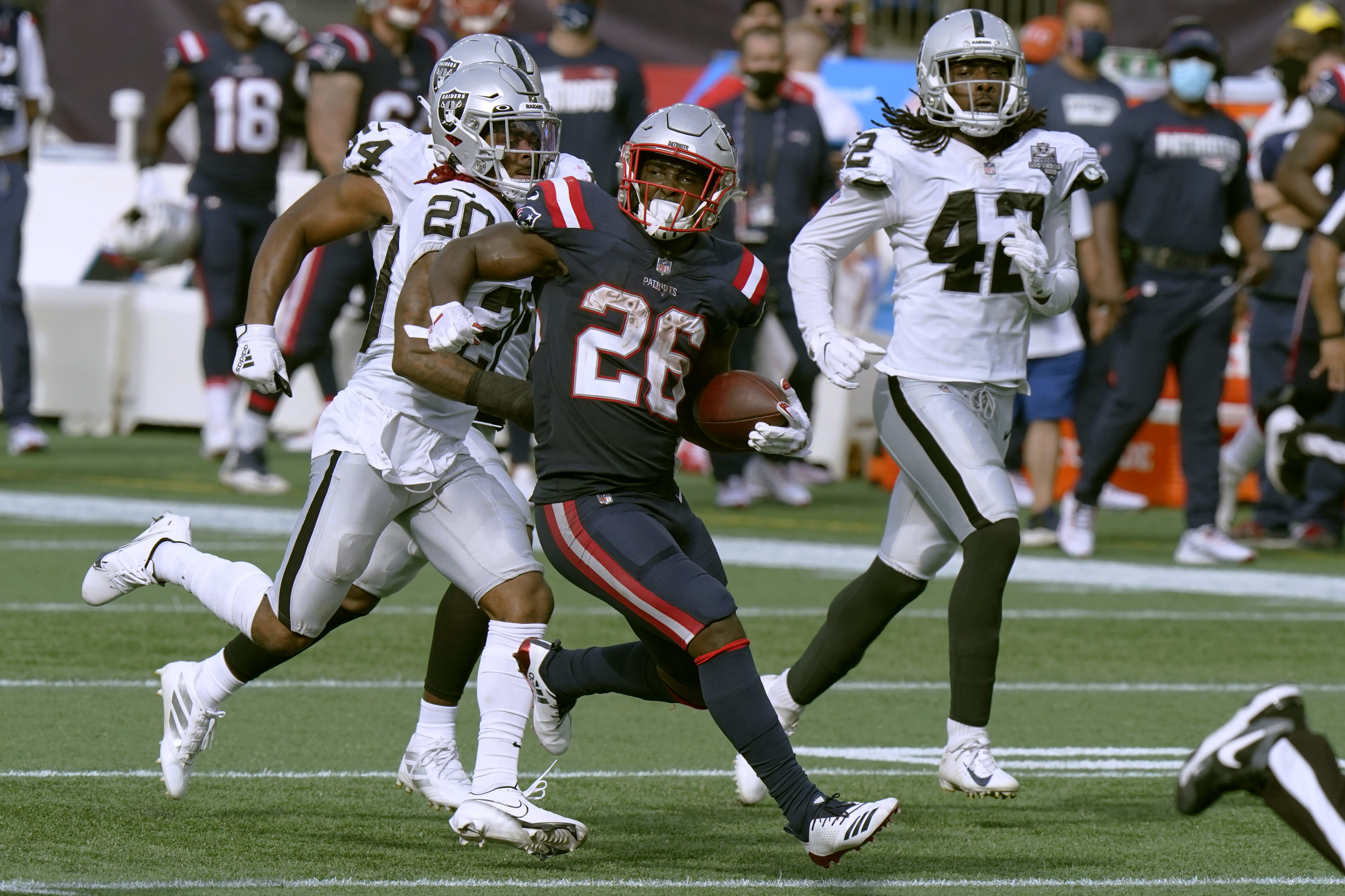 New England Patriots running back Sony Michel (26) gains yardage against the Las Vegas Raiders in the second half of an NFL football game, Sunday, Sept. 27, 2020, in Foxborough, Mass. (AP Photo/Steven Senne)