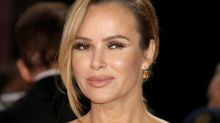Amanda Holden puts up dazzling Christmas tree and jokes she could sit on top in angelic white dress