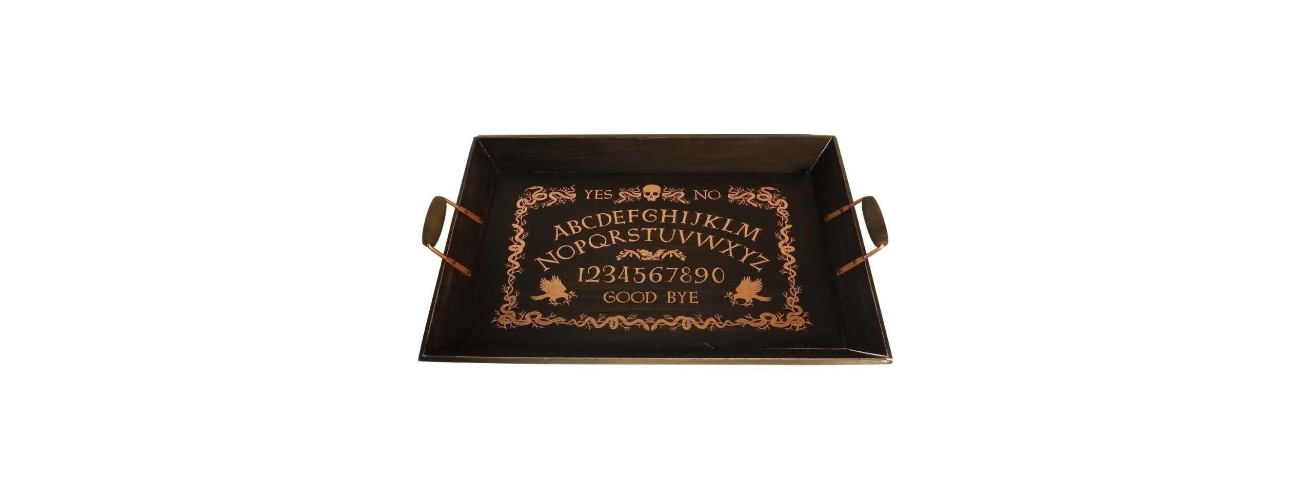 """<p>Nothing says Halloween like a <a href=""""http://www.delish.com/cooking/videos/a49630/how-to-make-ouija-board-cake-video/"""" rel=""""nofollow noopener"""" target=""""_blank"""" data-ylk=""""slk:Ouija"""" class=""""link rapid-noclick-resp"""">Ouija</a> board. This tray turns the game into a platter for all your <a href=""""http://www.delish.com/holiday-recipes/halloween/g1681/grown-up-halloween-party/"""" rel=""""nofollow noopener"""" target=""""_blank"""" data-ylk=""""slk:decorative eats"""" class=""""link rapid-noclick-resp"""">decorative eats</a>.</p><p><strong>Price</strong>: $20</p><p><a href=""""https://www.target.com/p/halloween-spirit-board-serving-tray-hyde-and-eek-boutique-153/-/A-52354273#lnk=newtab"""" rel=""""nofollow noopener"""" target=""""_blank"""" data-ylk=""""slk:Get it here."""" class=""""link rapid-noclick-resp"""">Get it here.</a></p>"""