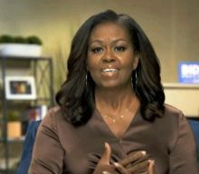 'When we do exist, we exist as a threat': Michelle Obama says even she has been treated as 'invisible' by white people