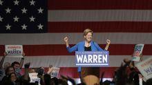 Warren rallies packed Seattle crowd, slams Bloomberg