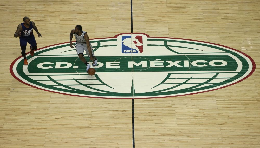 The Spurs' Kawhi Leonard dribbles against the Suns' P.J. Tucker during an NBA game in Mexico City on Jan. 14, 2017. The NBA is working to launch a new G League franchise in Mexico City. (AP)
