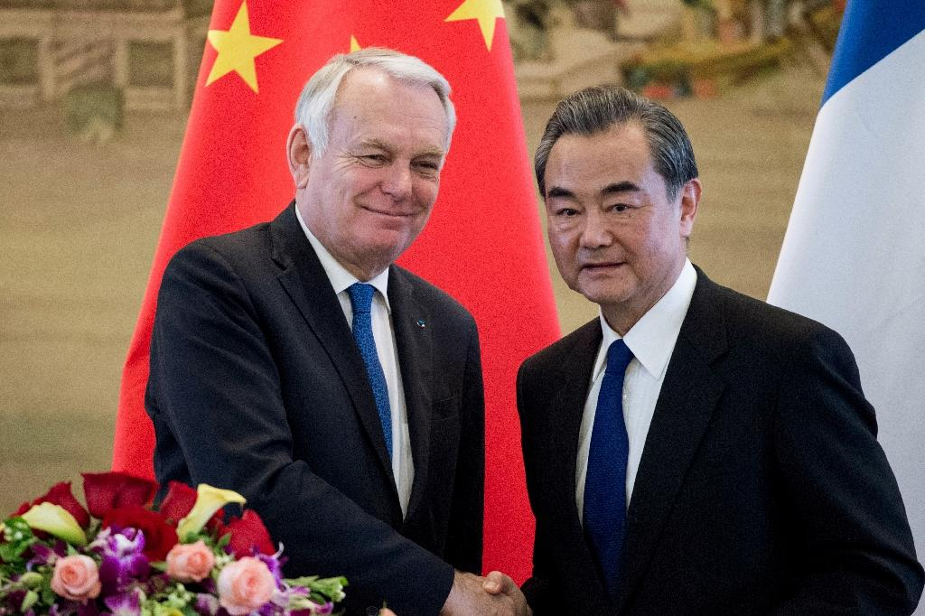 French Foreign Minister Jean-Marc Ayrault (left) is in Beijing for talks with his Chinese counterpart Wang Yi (AFP Photo/Fred DUFOUR)