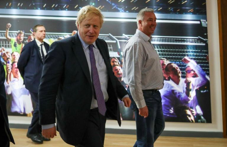 Britain's Prime Minister Boris Johnson during a Conservative Party general election campaign visit to Red Bull Racing in Milton Keynes. Feeling confident he has already published his plans for his first 100 days in office