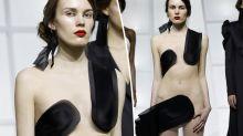 Model risks wardrobe malfunction in very bizarre outfit