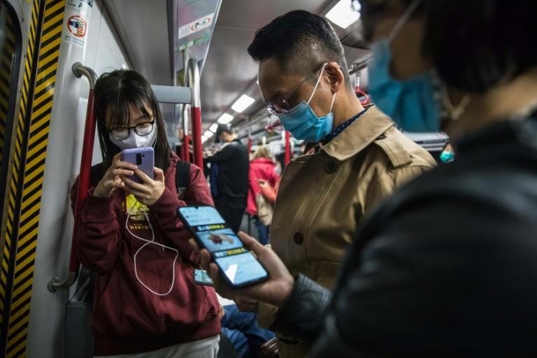 """Hong Kong scientists say """"draconian"""" measures are needed to stop the spread of the new virus"""