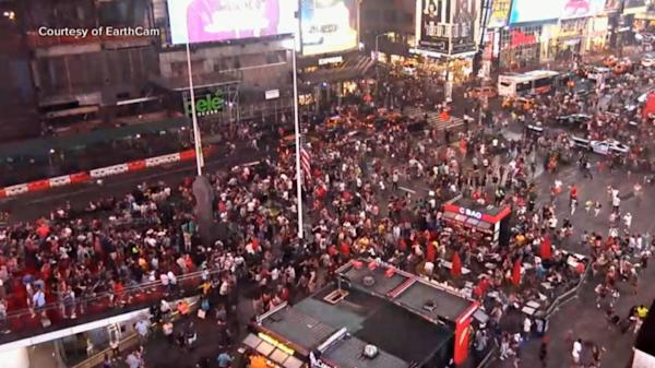 Panic erupts in Times Square when motorcycle backfiring
