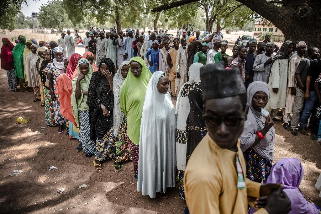 Wait: Voters queue at a polling station in Malkohi refugee camp in Adamawa state -- a facility for people displaced by the Boko Haram jihadist insurgency (AFP Photo/Luis TATO)