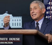 The Latest: Fauci says 'yes right on the spot' to Biden