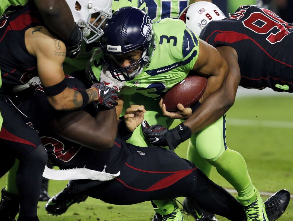 Seattle Seahawks quarterback Russell Wilson was removed from a game to be checked for a concussion, but never appeared to get checked. (AP)
