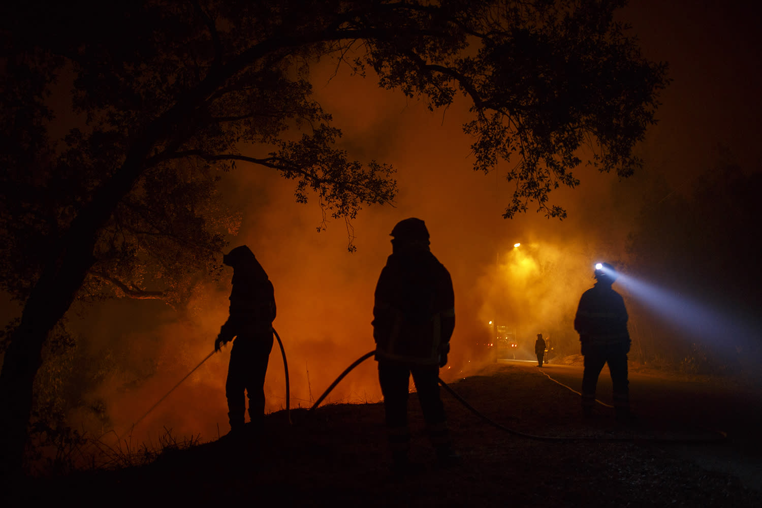 <p>Firefighters battle a forest wildfire next to Vilarinho village, near Lousa on Oct. 16, 2017 in Coimbra region, Portugal. (Photo: Pablo Blazquez Dominguez/Getty Images) </p>