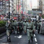 Petrol bombs thrown in Hong Kong metro, protesters defy face mask ban