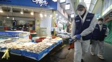 South Korean cases jump, China counts 150 more virus deaths