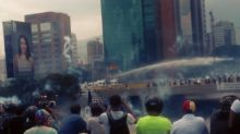 Police Fire Water Cannons, Tear Gas at Caracas Protesters