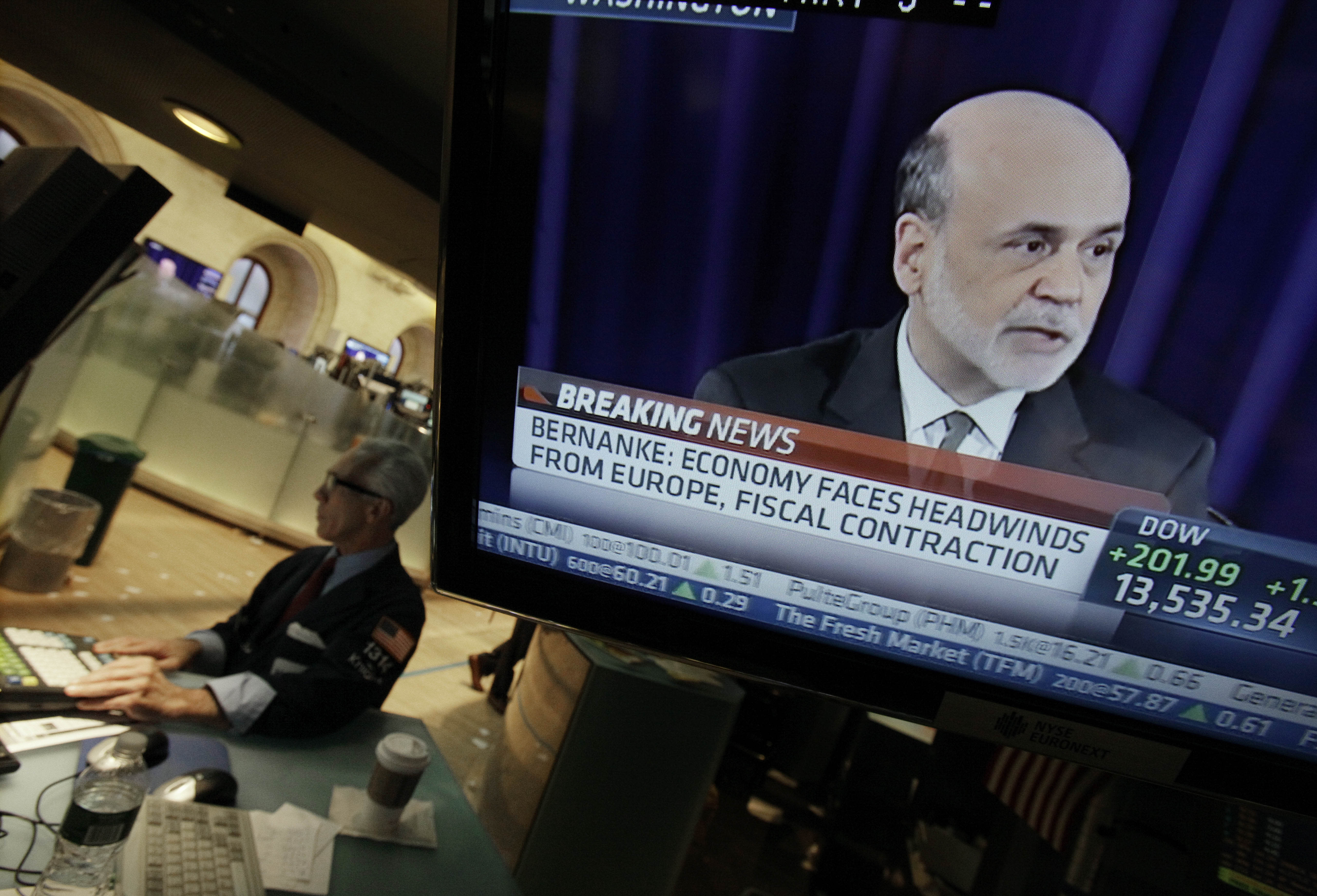 FILE - In this Thursday, Sept. 13, 2012 file photo, Specialist David Pologruto works at his post on the floor of the New York Stock Exchange, as Federal Reserve Chairman Ben Bernanke holds a news conference in Washington, Thursday, Sept. 13, 2012. No sooner did the Federal Reserve unveil a bold plan to juice the U.S. economy than it dangled the prospect of doing even more. Investors celebrated by sending stock prices jumping. Economists were less impressed. Many wonder how much the Fed's action would help. (AP Photo/Richard Drew, File)
