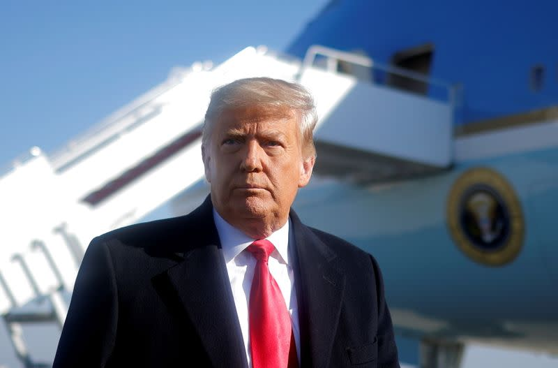 Trump, in wave of Tuesday pardons, so far not planning to pardon himself: source