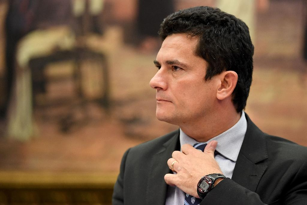Federal Judge Sergio Moro gestures during a public hearing at the special committee of the Chamber of Deputies that discusses changes in the code of criminal procedure in Brasilia, Brazil, on March 30, 2017 (AFP Photo/EVARISTO SA)