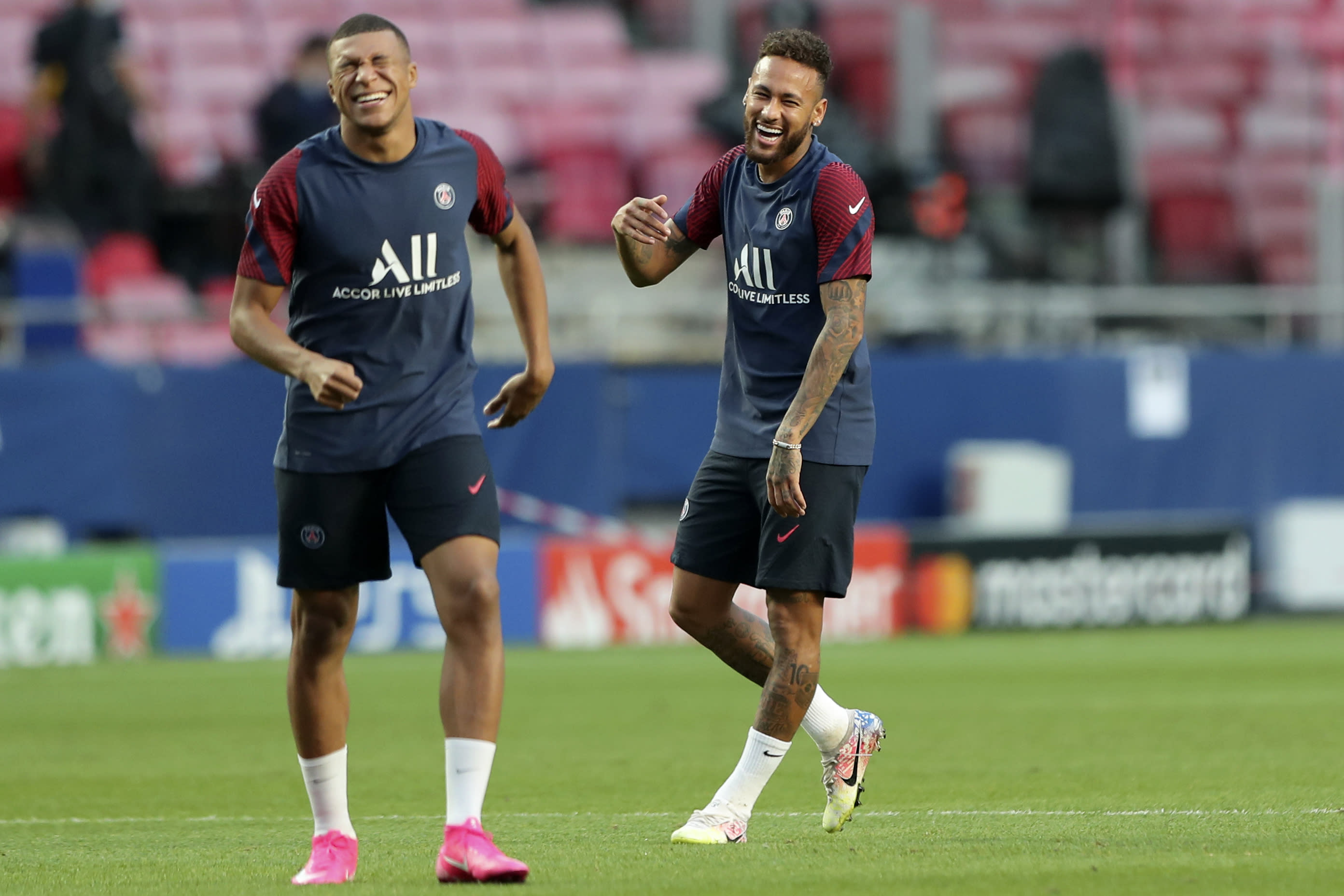 PSG's Neymar jokes with Kylian Mbappe, left, during a training session at the Luz stadium in Lisbon, Saturday Aug. 22, 2020. PSG will play Bayern Munich in the Champions League final soccer match on Sunday. (Miguel A. Lopes/Pool via AP)
