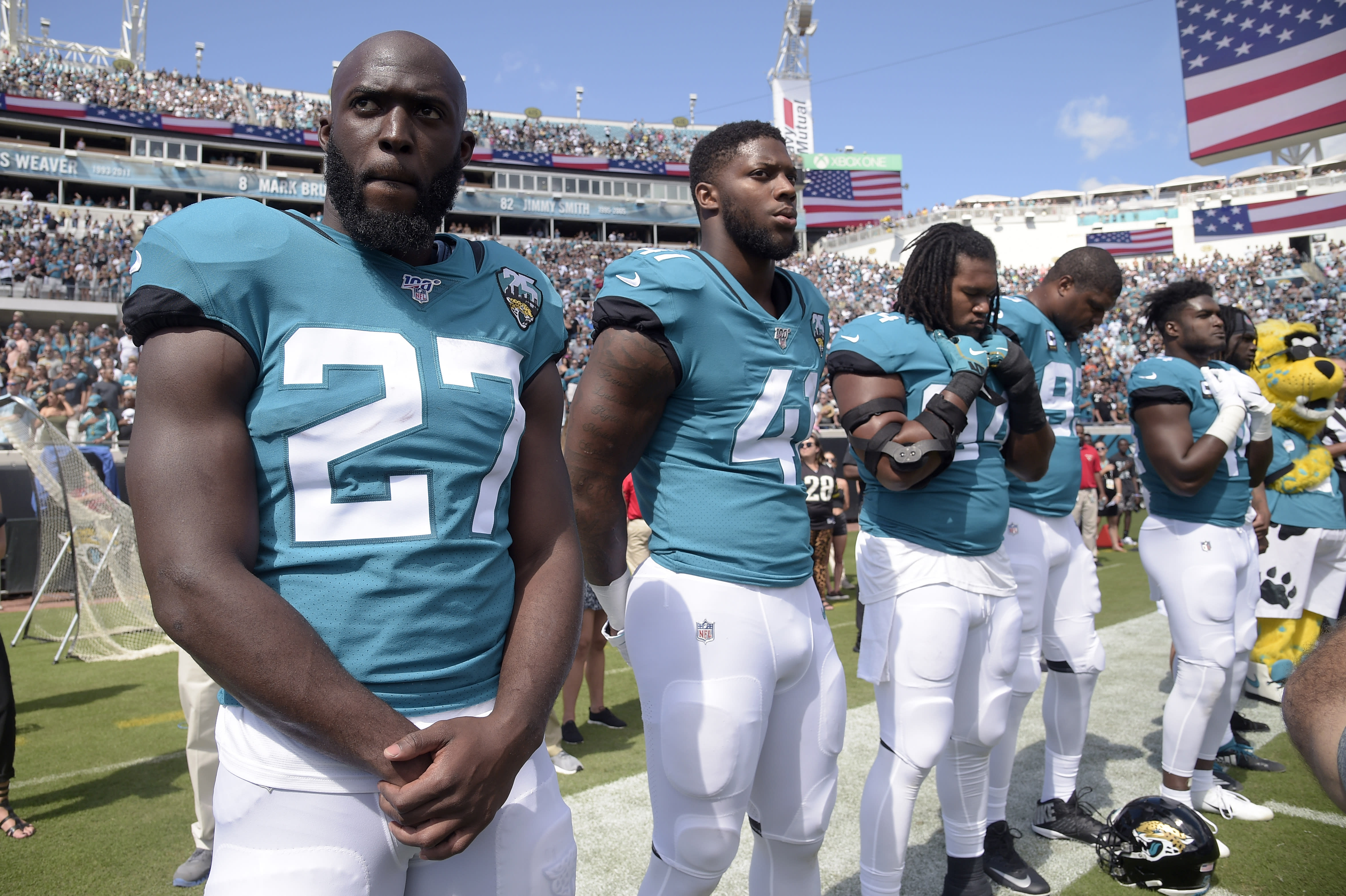 FILE - Jacksonville Jaguars running back Leonard Fournette (27) and defensive end Josh Allen (41) stand on the sideline for the playing of the national anthem before an NFL football game against the New Orleans Saints Sunday, Oct. 13, 2019, in Jacksonville, Fla. The Jacksonville Jaguars have waived running back Leonard Fournette, a stunning decision that gets the team closer to purging Tom Coughlin's tenure.(AP Photo/Phelan M. Ebenhack, File)