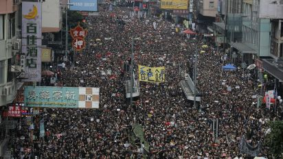 Huge Hong Kong protests draw apology from leader