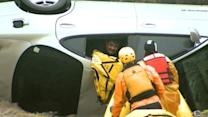 Man Pulled From Overturned Car in Dramatic Flood Rescue
