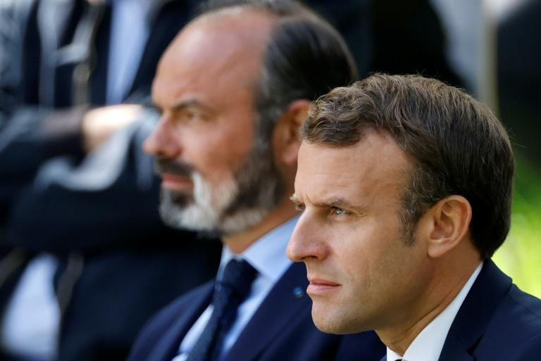 """French President Emmanuel Macron, right, has parted ways with Edouard Philippe as he charts a """"new course"""" in the wake of the coronavirus crisis. (AFP Photo/CHRISTIAN HARTMANN)"""