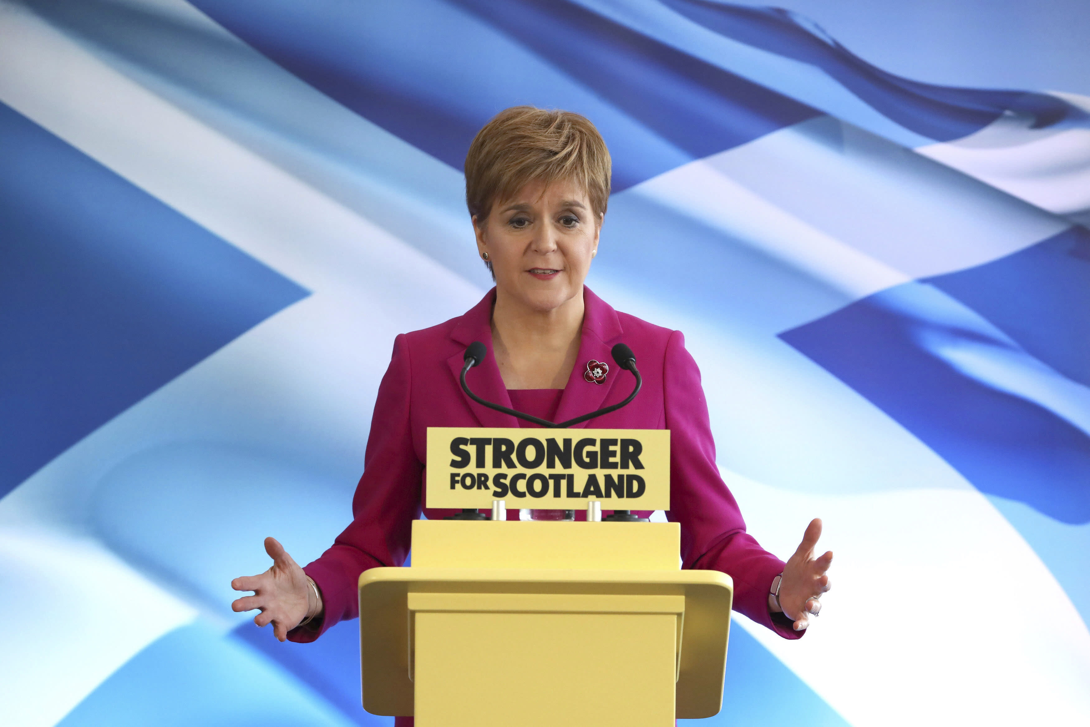 Scottish National Party (SNP) leader Nicola Sturgeon speaks at the launch of the party's General Election campaign backdropped by the Scottish saltire flag, in Edinburgh, Scotland, Friday Nov. 8, 2019. The Scottish National Party is officially launching its campaign for Britain's upcoming Dec. 12 election, with the SNP hoping to put Scotland a step closer to independence. (Andrew Milligan/PA via AP)