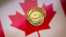 Loonie sticks to narrow range ahead of Fed rate decision