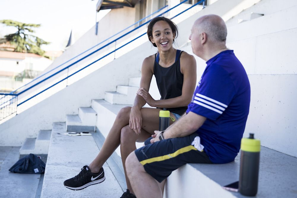 Katarina Johnson-Thompson does her best not to laugh when recalling Mark Lawford's 'arm-knee-leg' co-ordination