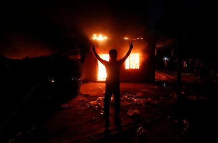 An Iraqi protester gestures in front of the burnt Iranian Consulate in Basra, Iraq September 7, 2018. REUTERS/Essam al-Sudani
