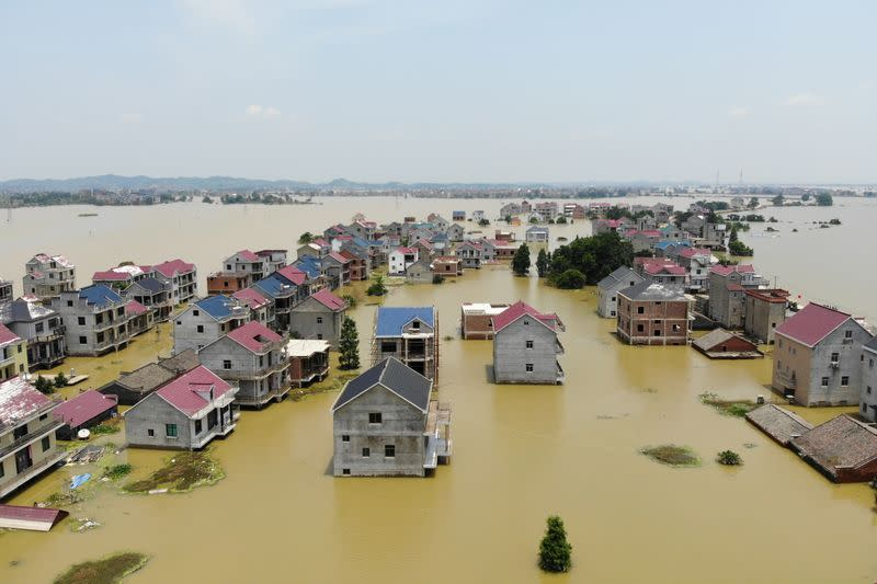 Buildings and farmlands are seen partially submerged in floodwaters following heavy rainfall in Poyang county of Jiangxi