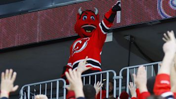 Why did Devils mascot smash a window?