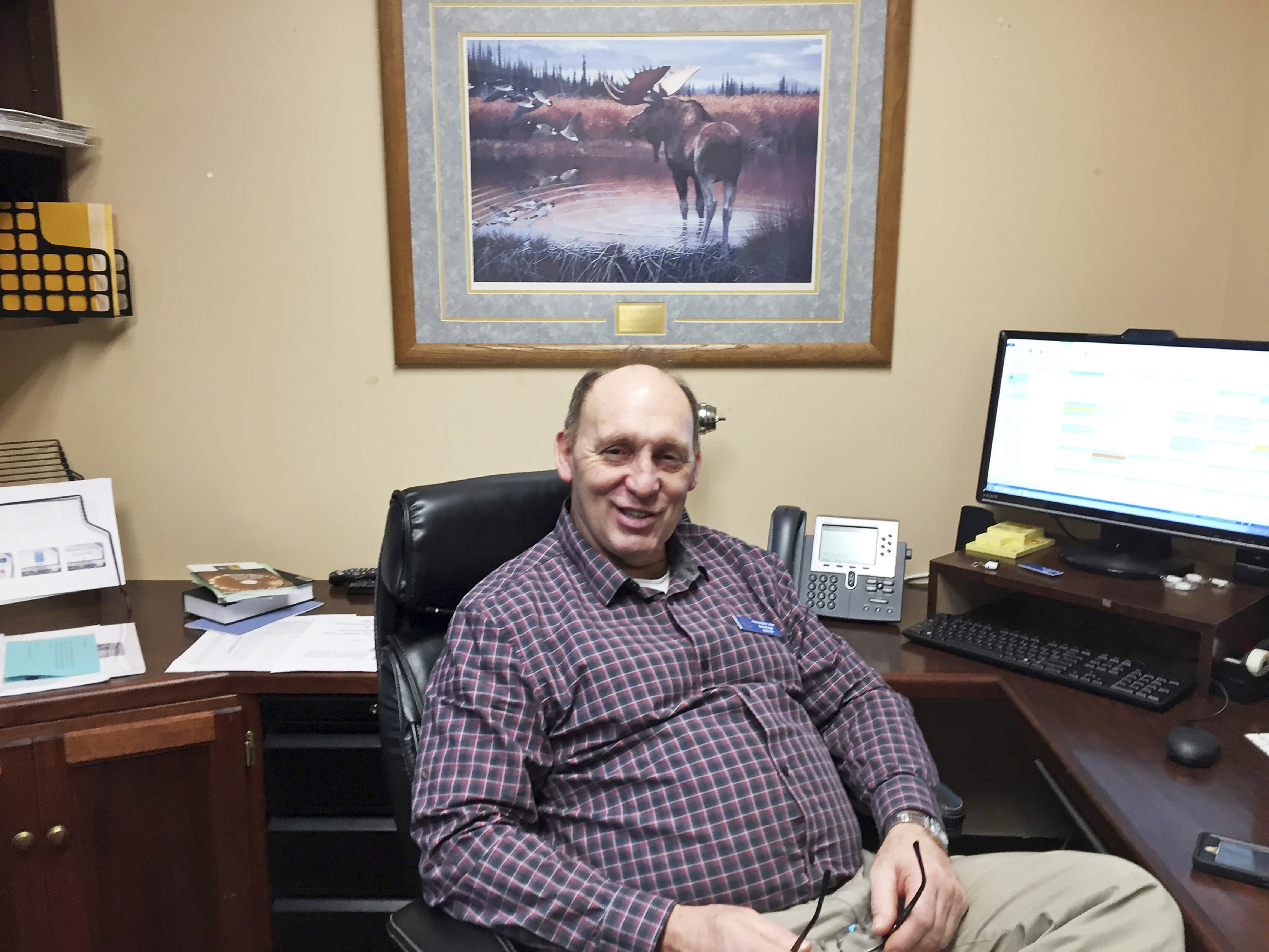 FILE - In this Jan. 16, 2017, file photo, then Rep.-elect Gary Knopp sits in his office at the Alaska Capitol in Juneau, Alaska. The Alaska House Majority says Alaska state Rep. Gary Knopp was killed in the mid-air collision of two planes near Soldotna on Friday, July 31, 2020. Alaska State Troopers would not confirm Knopp's death beyond saying the mid-air collision near the airport in Soldotna was a fatal crash. (AP Photo/Becky Bohrer, File)