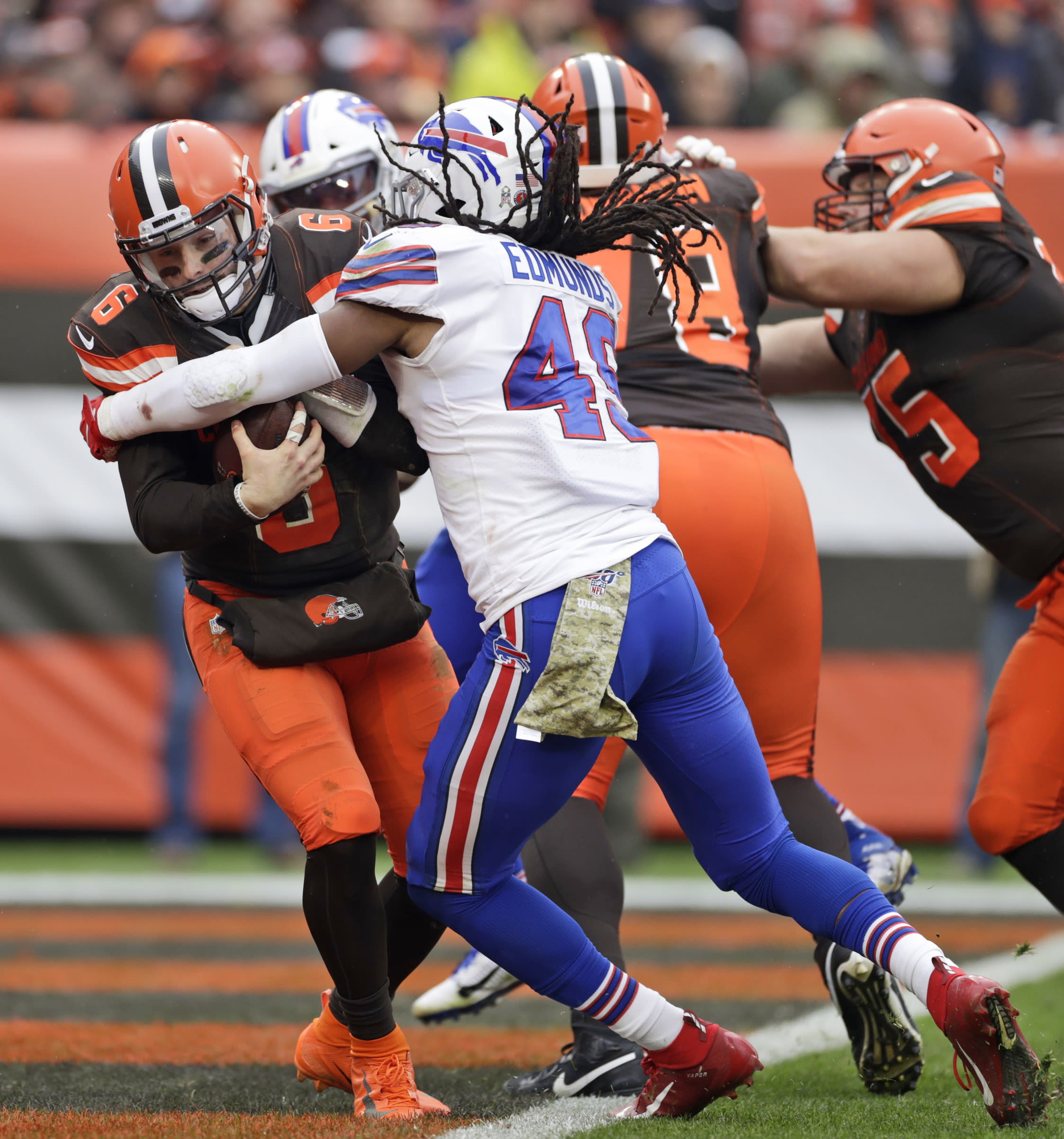 Cleveland Browns quarterback Baker Mayfield (6) is stopped by Buffalo Bills middle linebacker Tremaine Edmunds (49) for a safety during the second half of an NFL football game, Sunday, Nov. 10, 2019, in Cleveland. (AP Photo/Ron Schwane)
