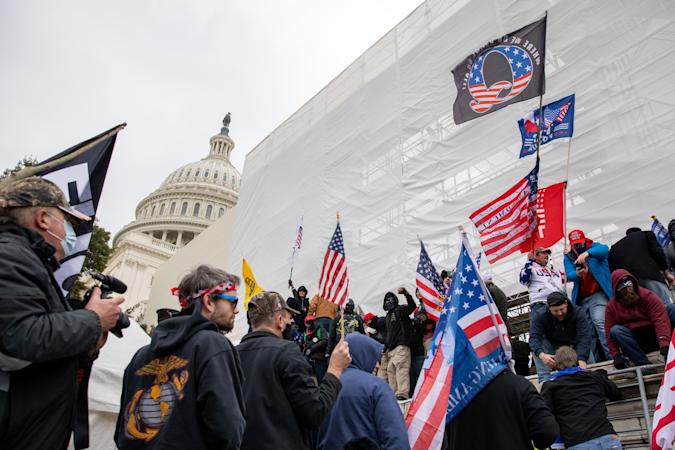 WASHINGTON DC - JANUARY 6: Flags fly near the U.S. Capitol as the perimeter was breached by pro-Trump protestors in Washington, DC on Wednesday, January 6, 2021. (Amanda Andrade-Rhoades/For The Washington Post via Getty Images)
