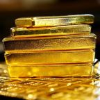 Gold firms as dollar retreats ahead of Fed meeting