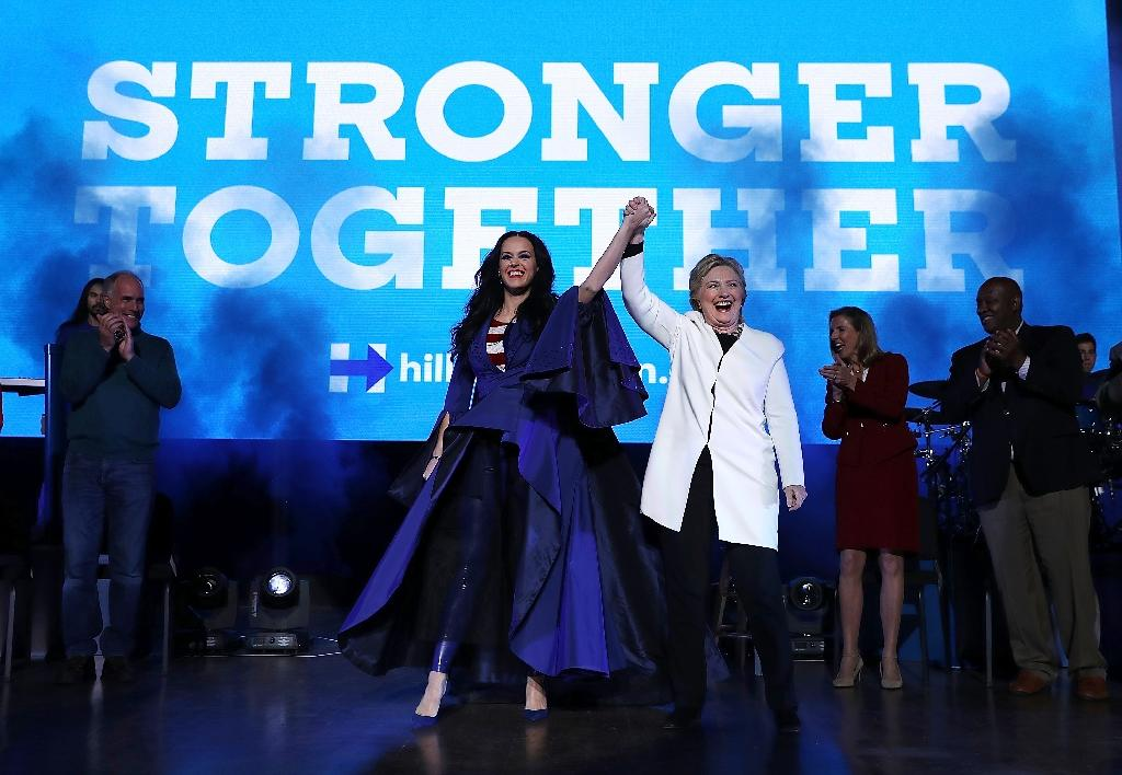 """Pop star Katy Perry, seen campaigning with Hillary Clinton November 5, 2016, told her fans not to """"sit still"""" or """"weep"""" after Donald Trump's election as US president (AFP Photo/Justin Sullivan)"""