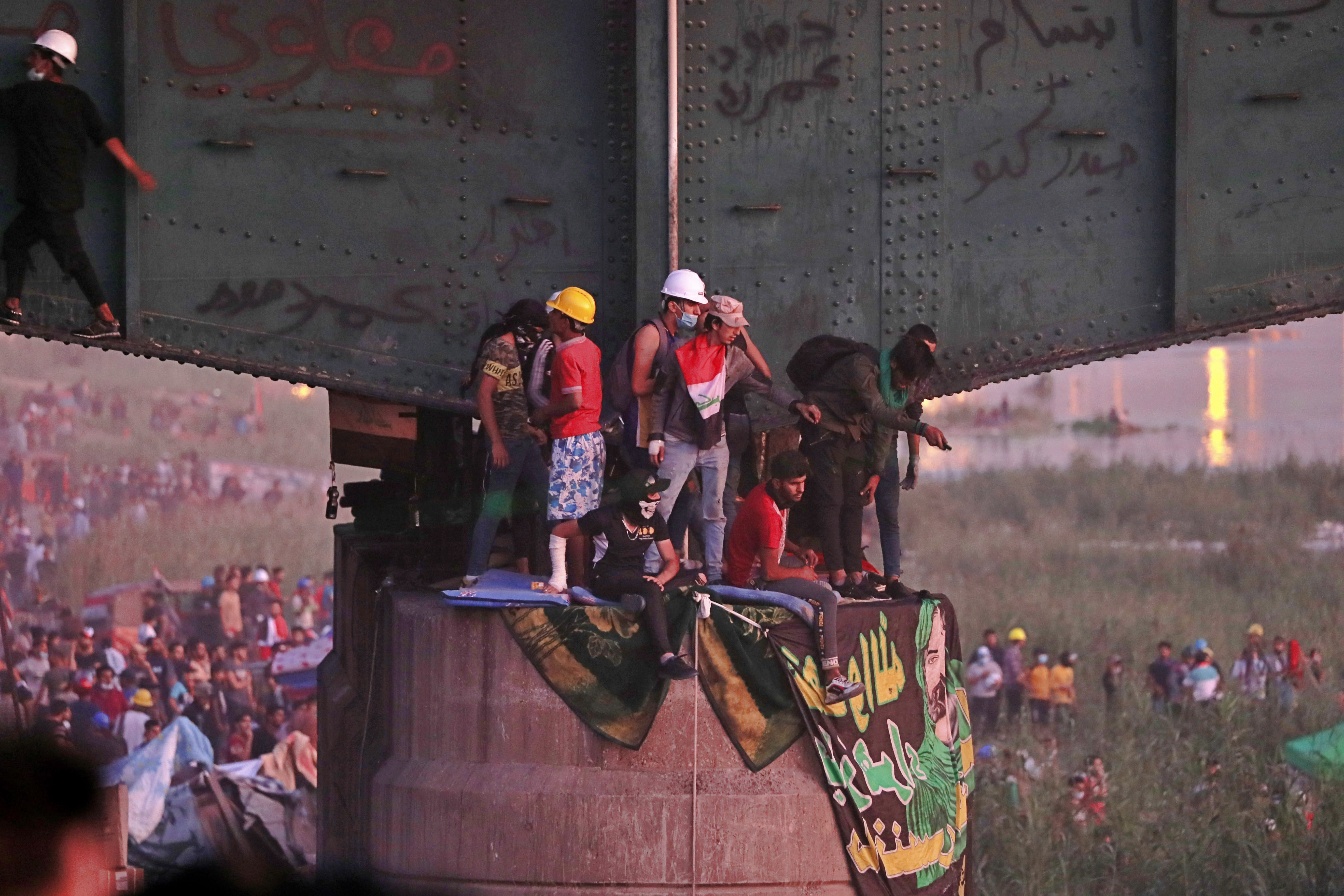 Protesters stage a sit-in under a bridge that leads to the Green Zone where many government offices and embassies are located, during ongoing anti-government protests in Baghdad, Iraq, Tuesday, Nov. 5, 2019. (AP Photo/Hadi Mizban)