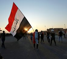 The Latest: Iraq official: Protester dies in bridge clashes