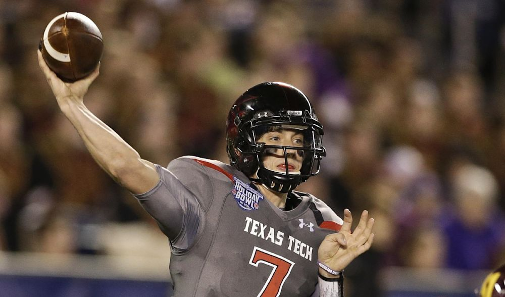 In this Dec. 30, 2013, file photo, Texas Tech quarterback Davis Webb throws a pass during his record setting first half against Arizona State during  the Holiday Bowl NCAA college football football game in San Diego.  Webb will be the starting quarterback this season