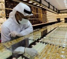 Gold gains as U.S.-China tensions boost demand