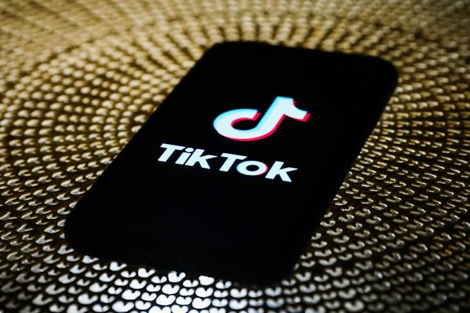 TikTok logo is seen displayed on a phone screen in this illustration photo taken on October 3, 2020. (Photo by Jakub Porzycki/NurPhoto via Getty Images)