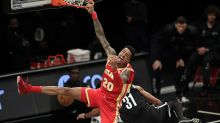 AP source: John Collins stays with Hawks for 5 years, $125M