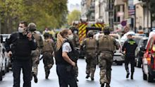 Charlie Hebdo: Two stabbed outside magazine's former offices in Paris after cartoons republished