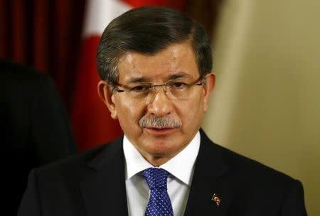 Turkish Prime Minister Ahmet Davutoglu addresses the media in Ankara