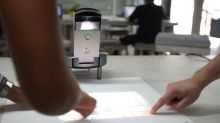 Transform any surface into a touchscreen computer with this projector